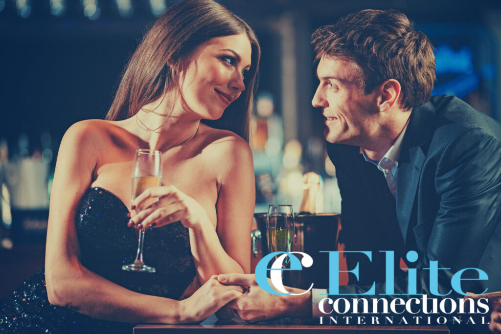 Portrait of well dressed couple enjoying champagne in a night club